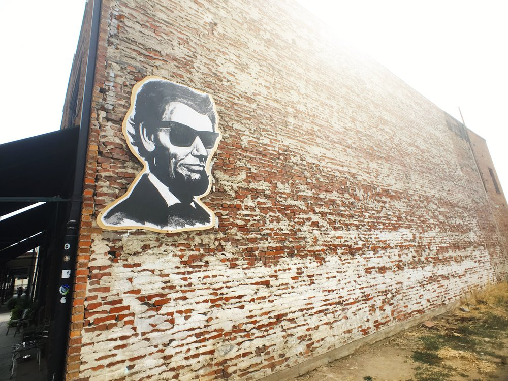 Four Score Coffee Shop in Roseville California. President Abraham Lincoln with sunglasses on.