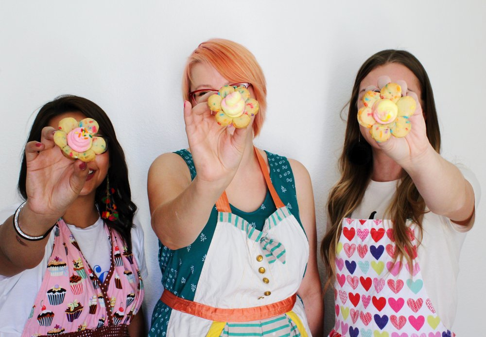 Cute aprons/ flower shaped sprinkle cookies/ pink and yellow lemon cheesecake filling/ pink hair