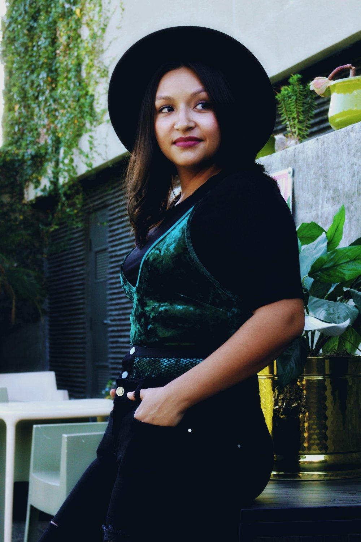 Emerald Green velvet bodysuit black wide brim fedora fishnet distressed denim