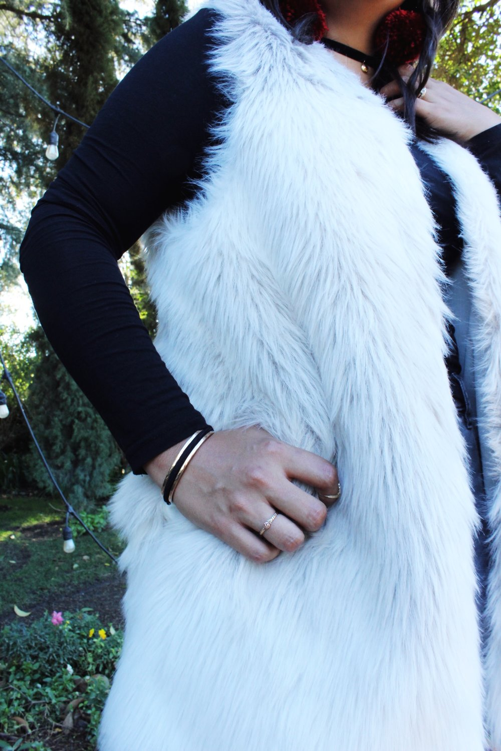 White Fur Jacket Maria Shireen bracelet