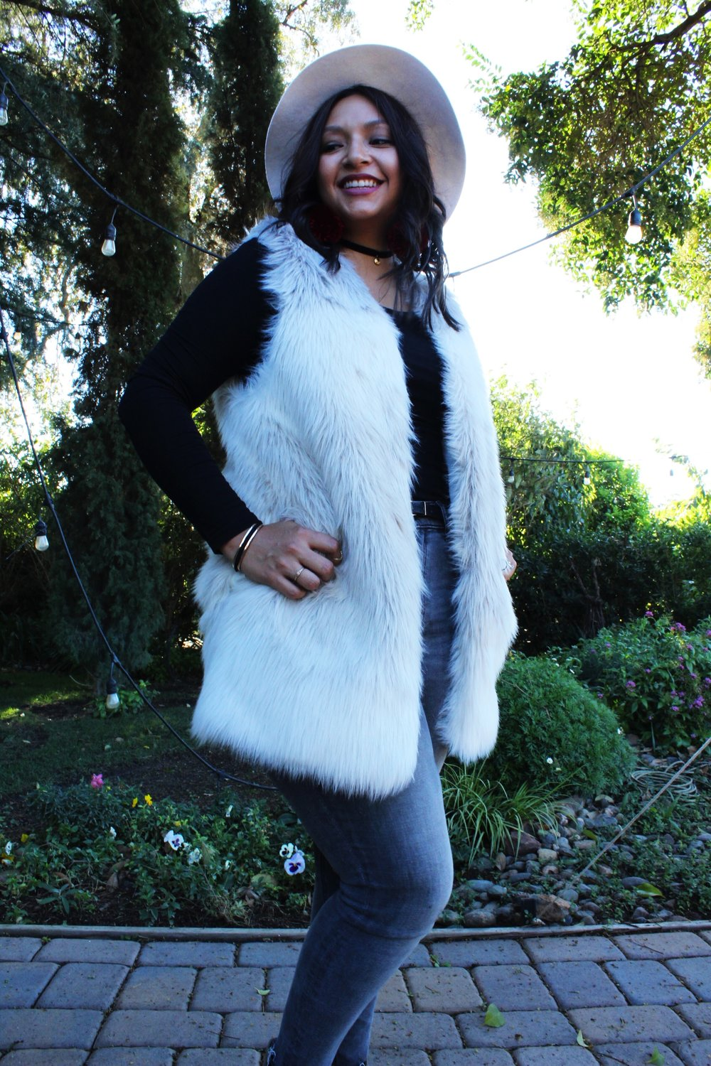 Wide brim fedora white fur jacket Lodi California winery