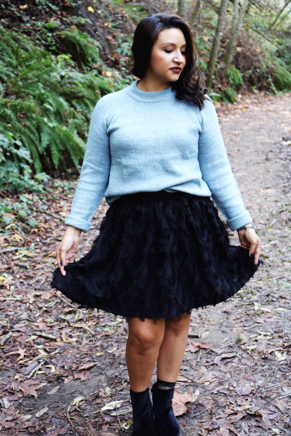 Ice blue sweater black skater skirt mesh socks with booties