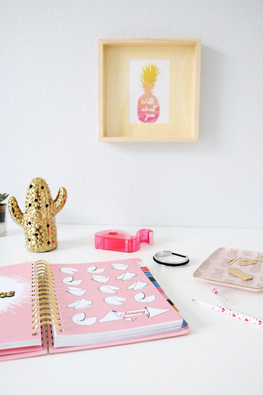 Bando Planner gold cactus statue pineapple framed photo white desk
