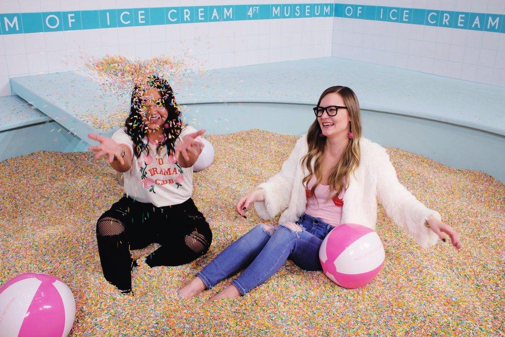 sprinkle pool, museum of ice cream, beach balls, white fur jacket
