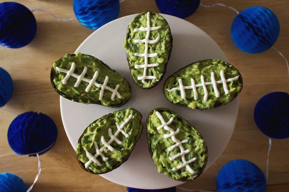 Football guacamole, avocado, sour cream, super bowl party decor