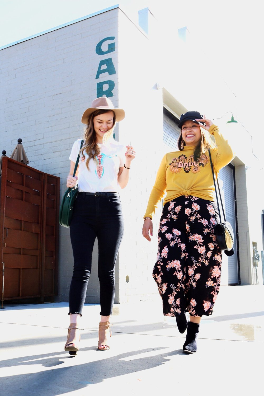 Dazey L.A. feminist t-shirts floral pants black denim camel open toe booties black suede booties Ban.do bags wide brim fedora cabby hat