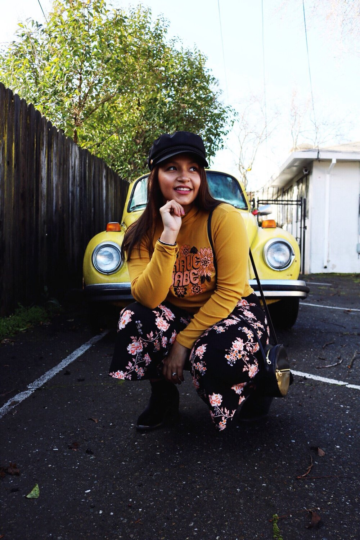 Dazey_LA feminist t-shirt Brace Babe t-shirt camel wide brim fedora Black and gold Ban.do BFF bag Yellow bug Floral pants black suede booties