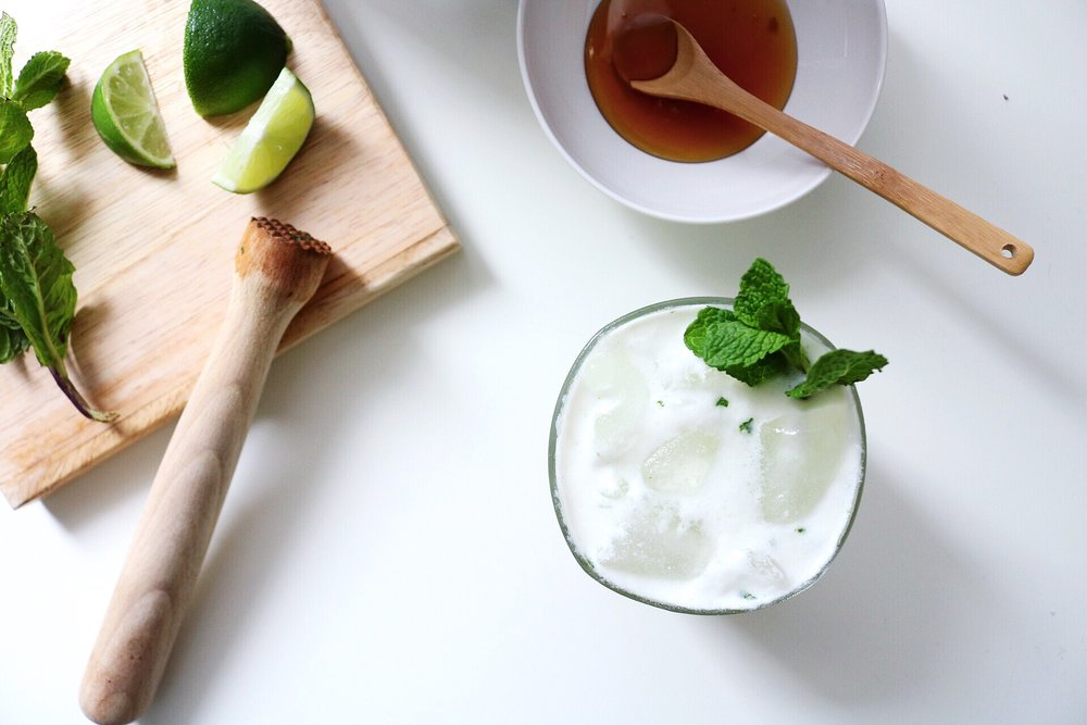 Muddled Lime and Mint Coconut Water Coconut Cream Honey Water Gin Cocktail
