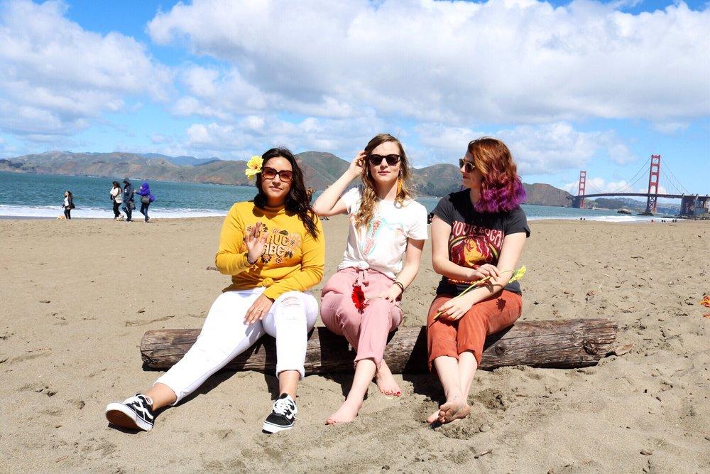 Daley_LA H&M Distressed White Denim Black and White Classic Vans Orange pants Pink Pants Feminist T-Shirts San Fransisco Beach Day Eye Buy Direct Sunglasses