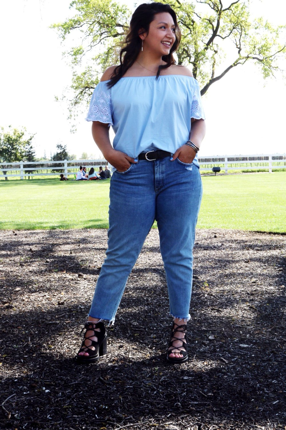 Outfit of the day for wine tasting an embroidered pastel blue off-the-shoulder top with light wash denim boyfriend jeans