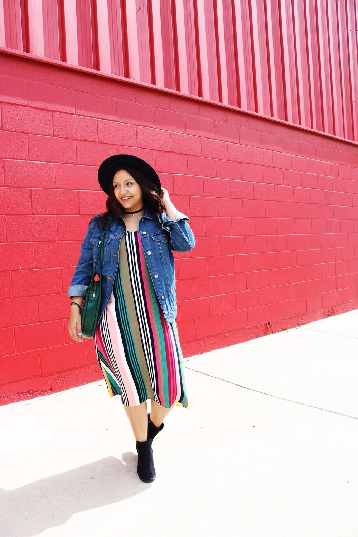 Express multicolor midi slip dress and denim jacket. Black fedora hat and black felt choker with gold details