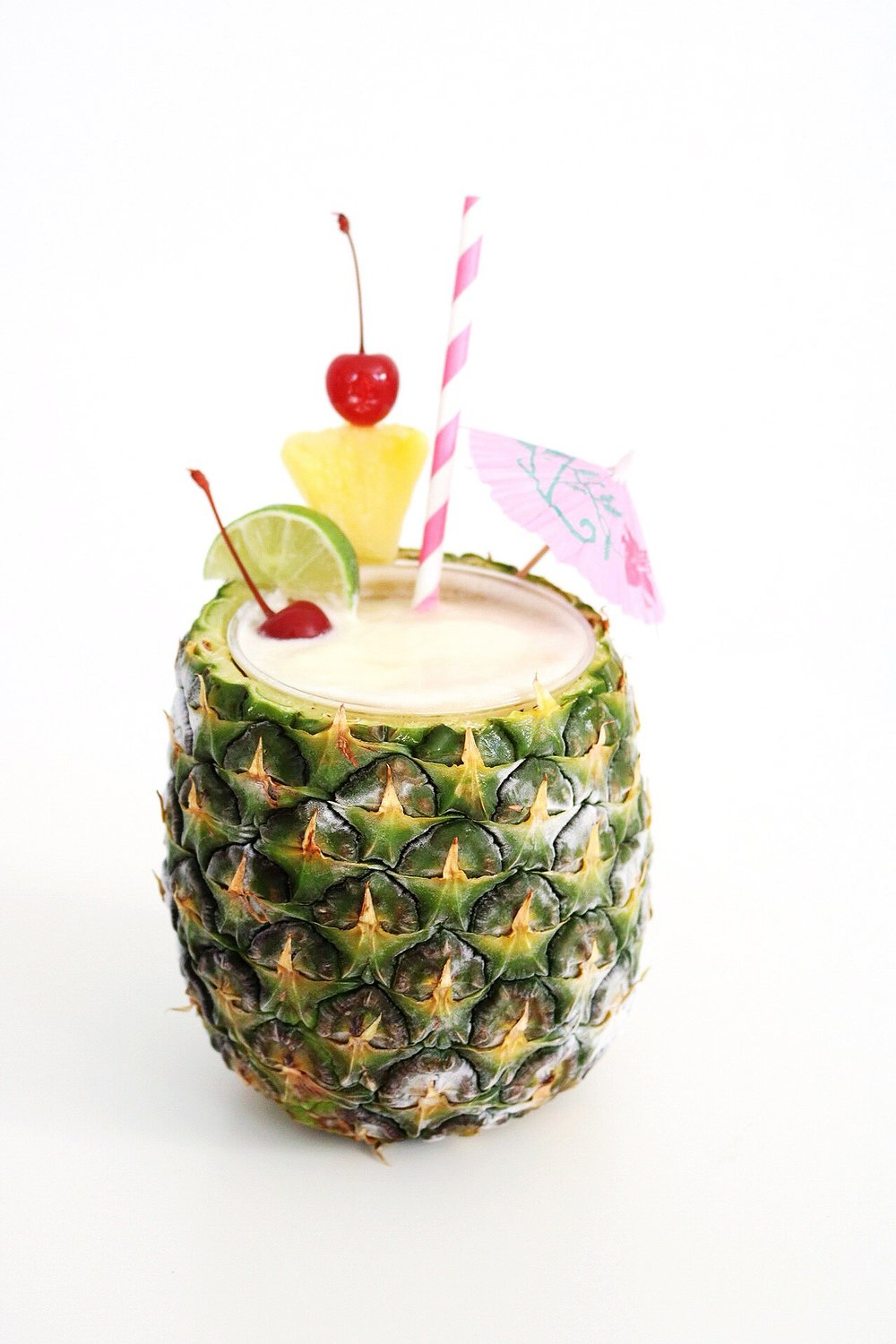 It's all about the garnishes and a dark rum float when it comes to a legit piña colada!