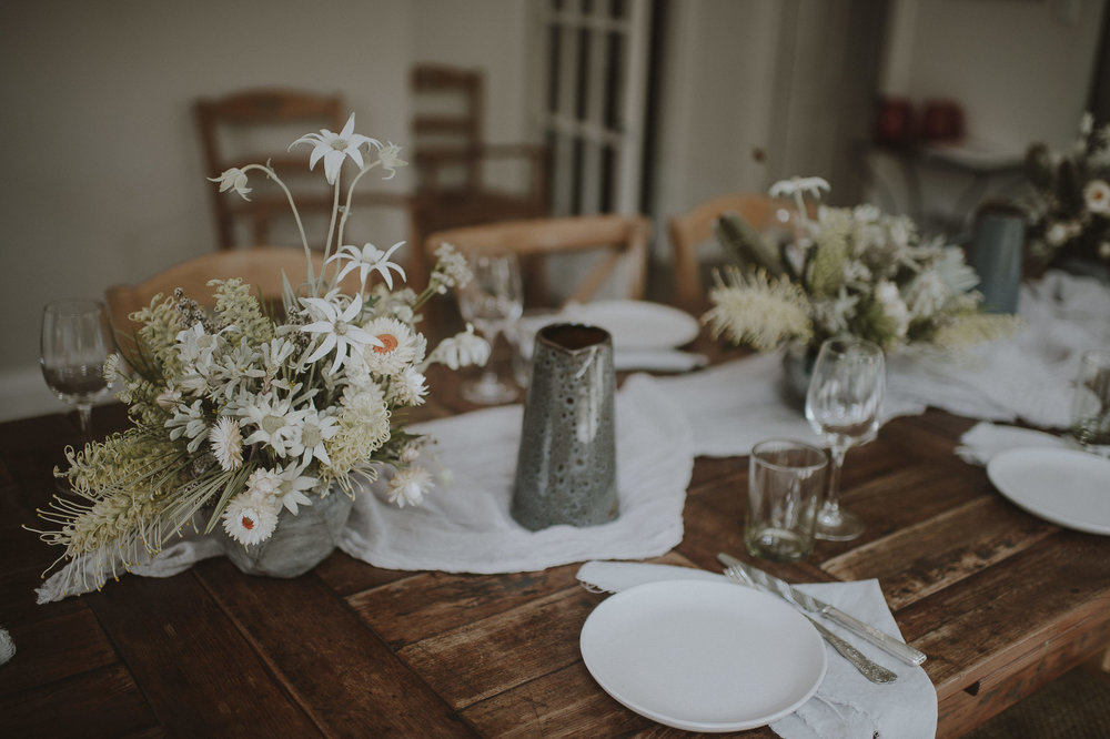 Crinkled natural fabrics such as linen, muslin, chiffon and silk can create that relaxed organic style whilst lightening up a timber table.