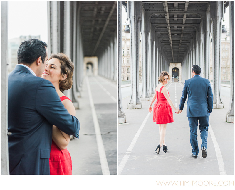 Paris Photographer Tim Moore taking pictures of Valentina (with her gorgeous red dress) and Henri in Paris walking under the Bir-Hakeim bridge