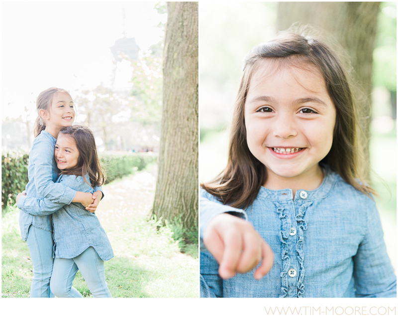 Girls hugging and smiling during their Paris family photo shoot with Tim Moore