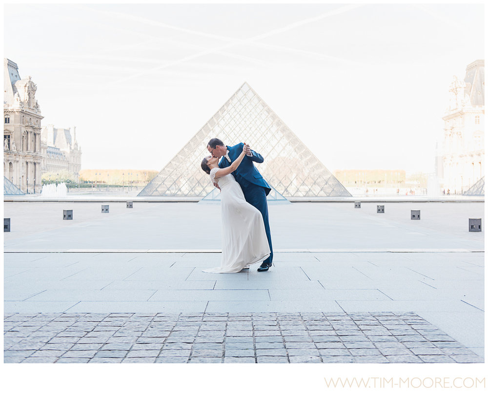 Paris photographer Tim Moore - Perrine and Boris dancing and kissing at the Louvre museum in Paris a few weeks after their Wedding