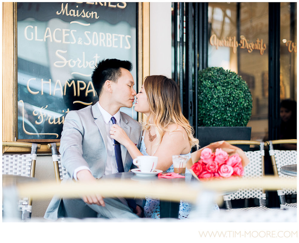 Paris photographer Tim Moore - Juli and Anh-Tuan deeply in love and having a fantastic time in this Café during their intimate Paris photo session