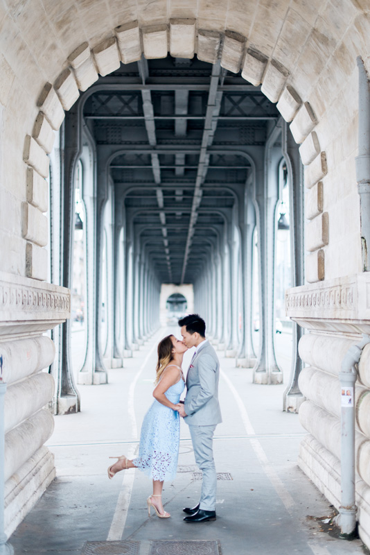 paris photographer - engagement photo shoot on a parisian bridge