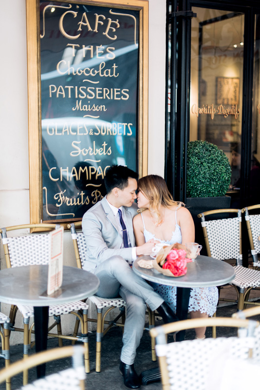 paris engagement photographer - photo shoot in a cute little parisian cafe