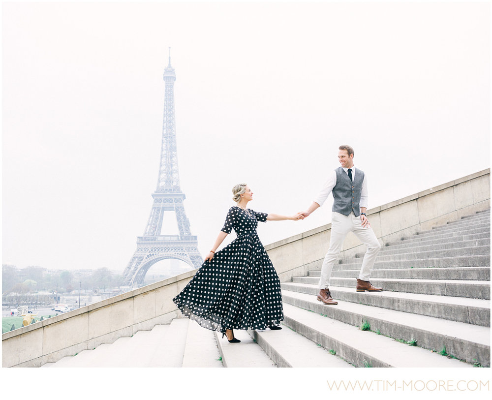 Paris Photographer - Couple photo shoot at the Eiffel Tower early in the morning in Paris, walking up the Trocadéro stairs together