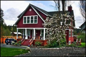 Cottage Red shingles and lap siding trimmed in white home for  sale