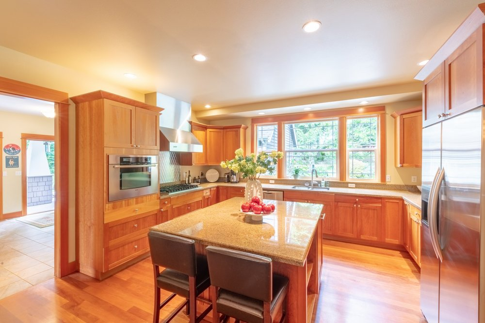 The  huge  kitchen  with  4  x  6  island  and  informal  eating  area  is  a  delightful  place  to  cook  and  entertain  guests.
