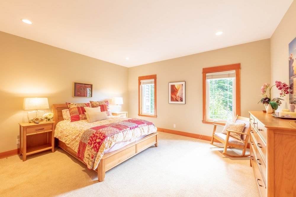 The  master  bedroom  is  generously  proportioned  with  large  windows  onto  the  garden  with  privacy  fence.
