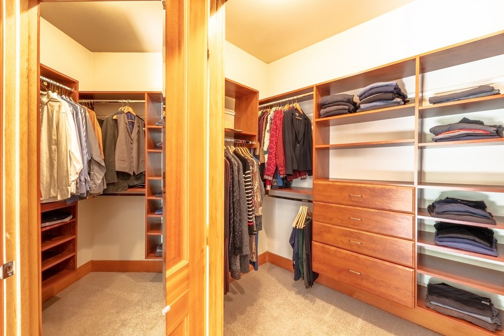 The  large  walk-in  closet  features  well-organized  California  Closets  built-ins.