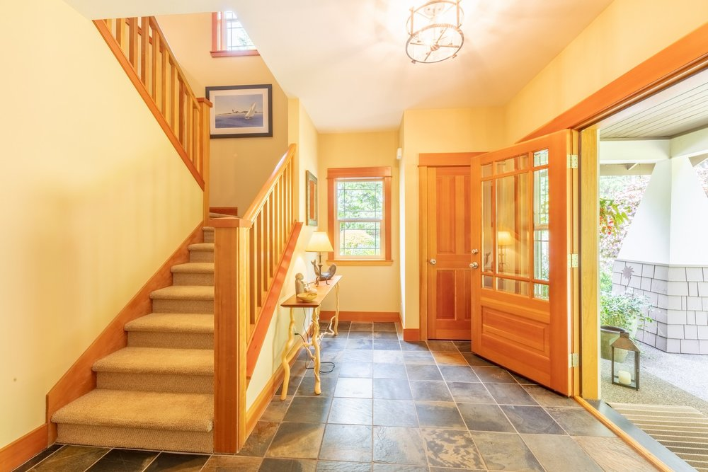 Enter  through  the  front  door  and  you  are  welcomed  into  a  large  entry  area  with  slate  floor  and  coat  closet.