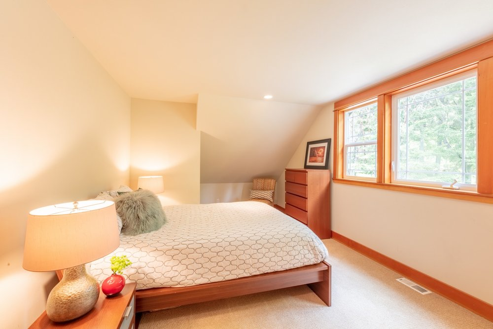 The  north  bedroom  has  both  large  and  small  closets  with  tons  of  storage  and  looks  over  the  front  garden  with  nearly  year  round  color.