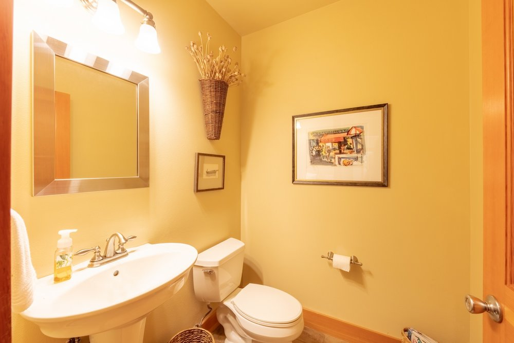 The  powder  room  is  conveniently  located  near  the  mud  room  and  is  easily  accessed  from  the  kitchen,  living  and  dining  rooms.