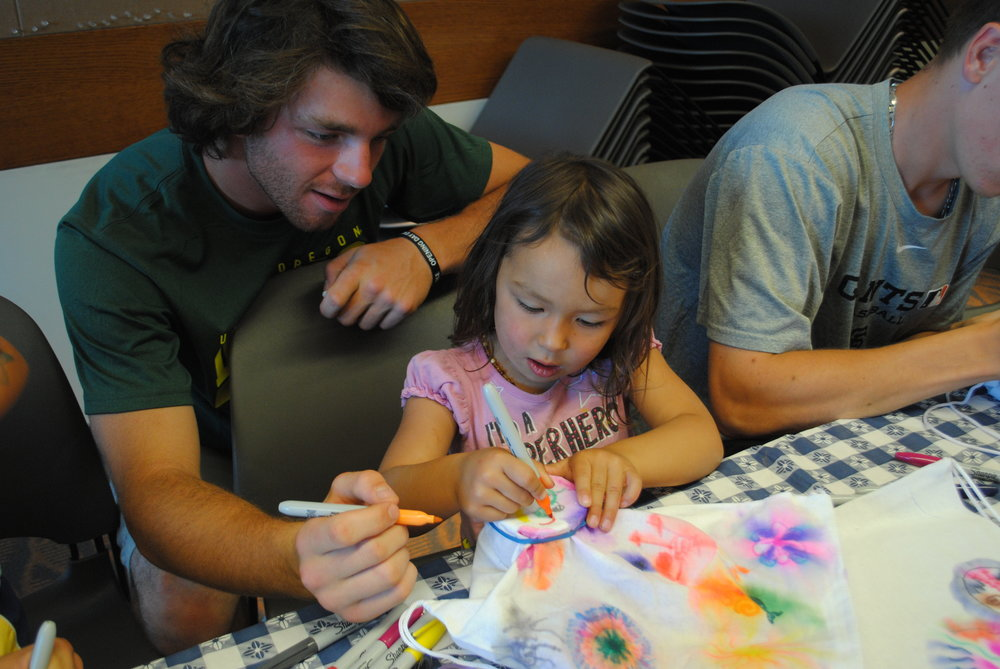 Olivia coloring with the Medford Rogues at the Medford Library