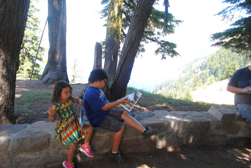 Olivia and Ilias filling out their Junior Ranger workbooks.