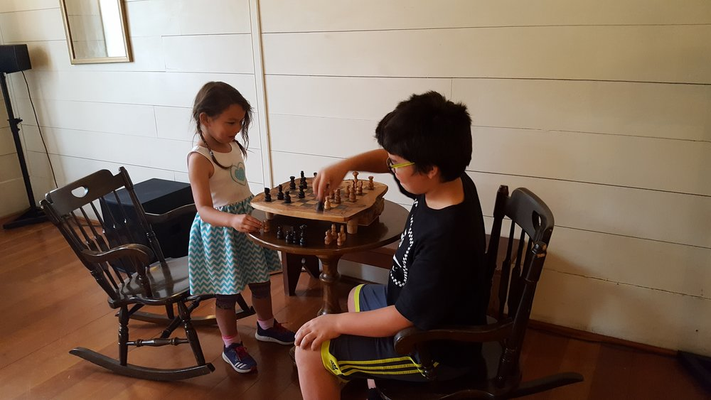 Kids playing Chess in the Ballrooom of Wolf Creek Inn.