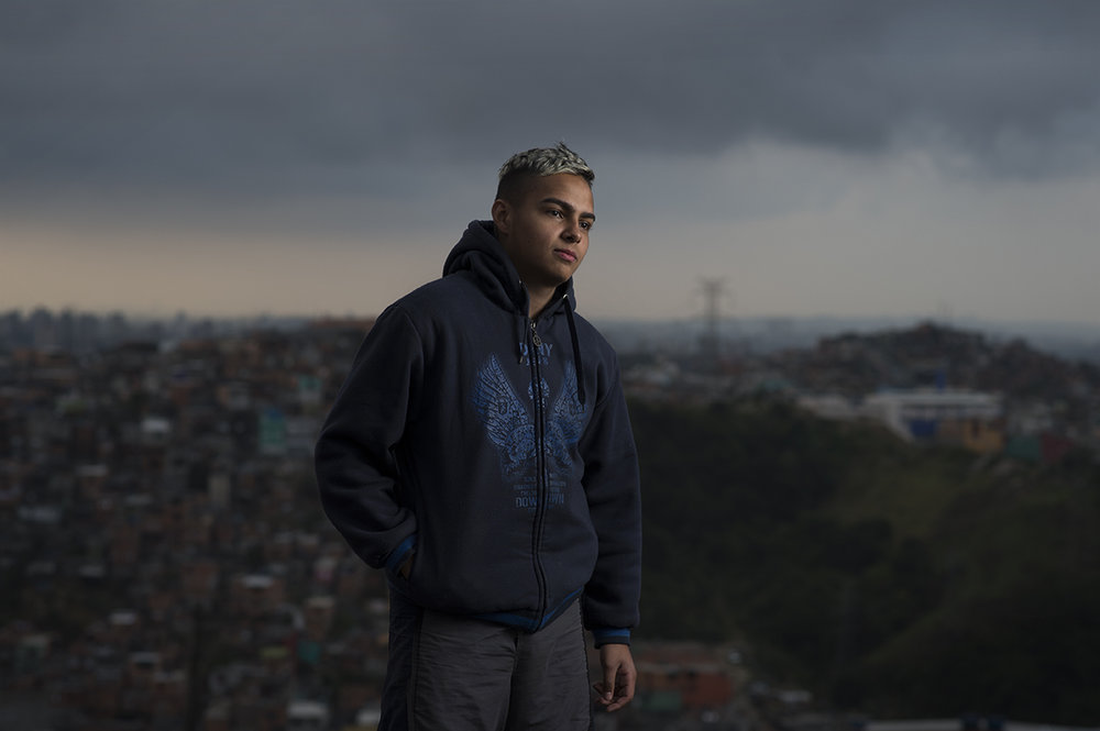 Wellington Gomes, 16, poses for the camera behind his home in São Bernardo favela, São Paulo, on August 12, 2016.