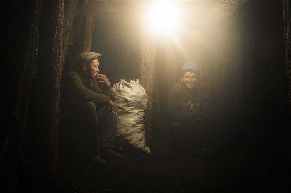 Private miners rest underground at the Nalaikh coal mine on April 14, 2016.