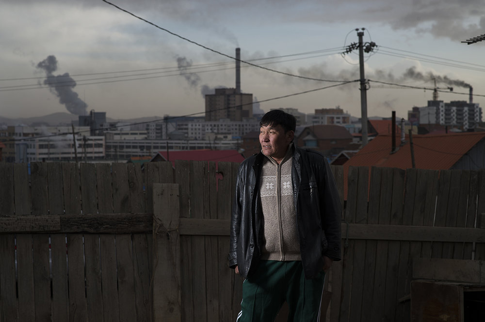Narantuya Chadraaval, a former herder, poses for the camera inside his property in Ulaanbaatar's ger district (slum) on April 12, 2016.
