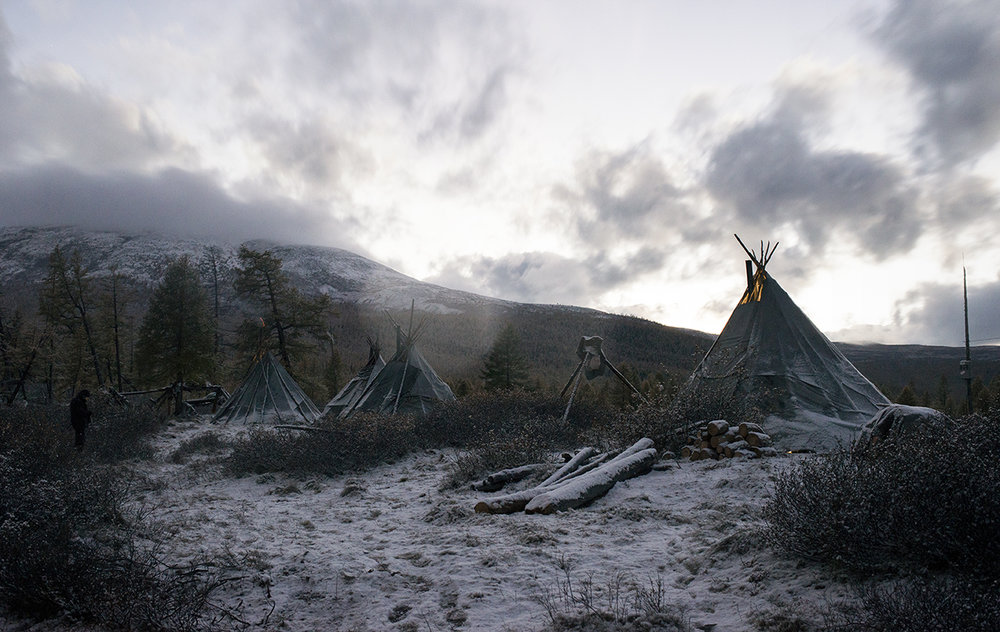 The Tsaatan people's ortz, the teepee-like tents, stand in the snow in East Taiga, Mongolia, on September 17. 2015.