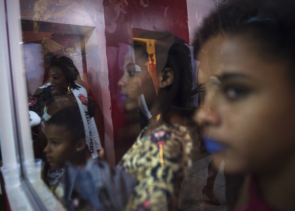 Young girls gather for a samba show at Salgueiro, one of Rio's top samba schools, on August 13, 2016.