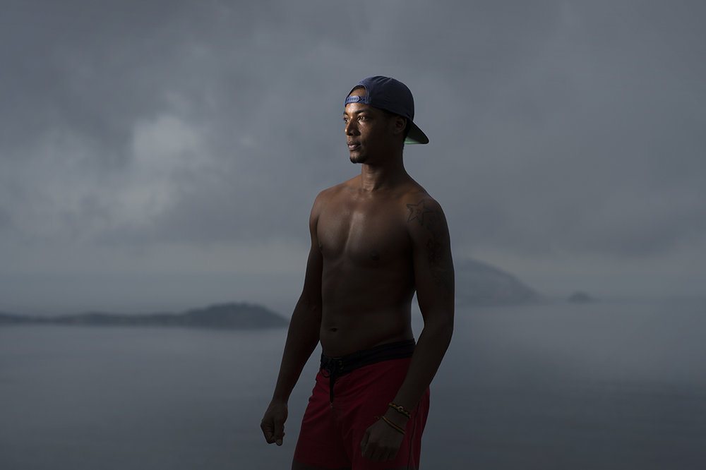 Rael Wenses poses in his neighbourhood atop Vidigal favela, Rio, on August 18, 2016. The aspiring model says it has been tough pursuing his dream to become a model as there hasn't been any opportunity for him.
