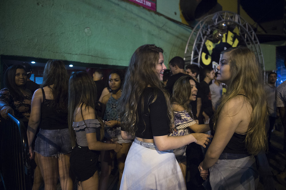Young girls queue up at a Baile funk party venue in Rio das Pedras, Rio, on August 19, 2016.
