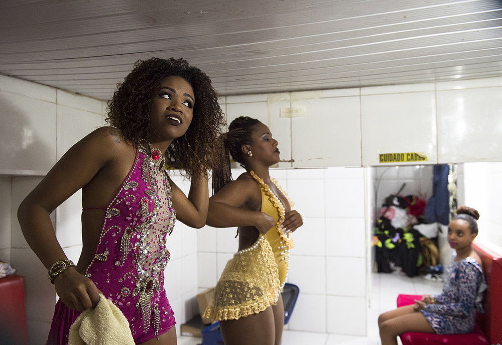 Samba dancers get ready to take to the stage at Salgueiro, one of Rio's top samba schools, on August 13, 2016.