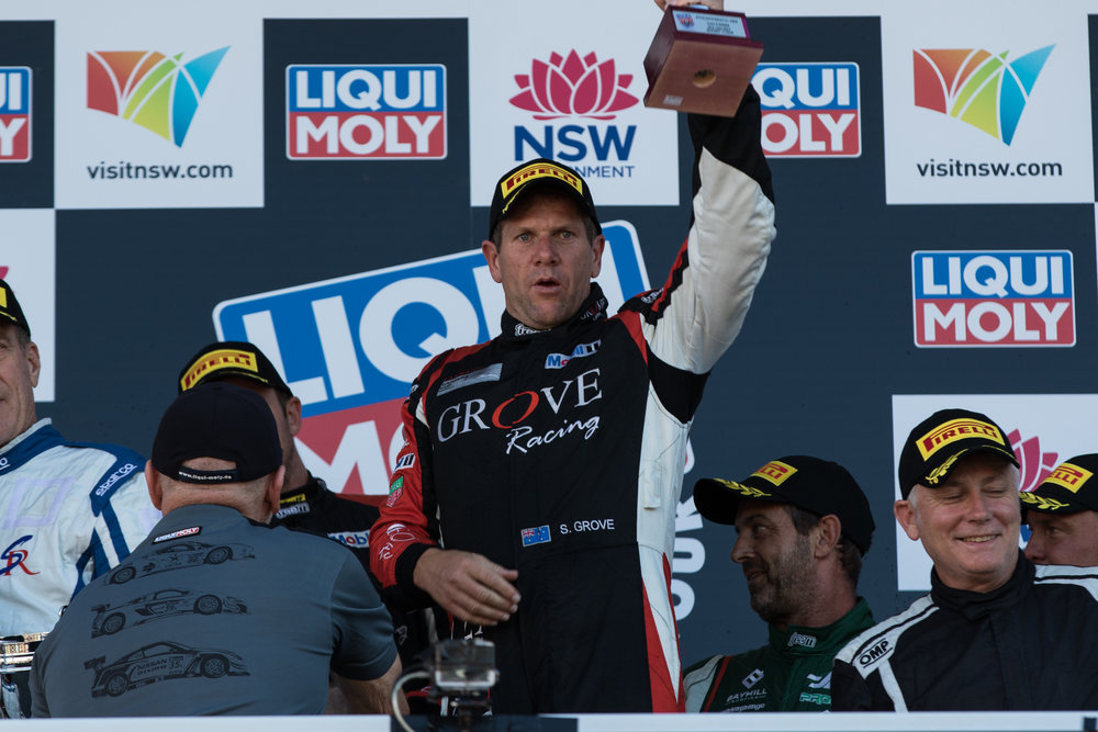 Stephen Grove standing on the top step of the Bathurst 12 Hour podium earlier this year.