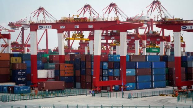 Free trade has led to a vast expansion of shipping and transfer of goods around the world. Image copyright REUTERS