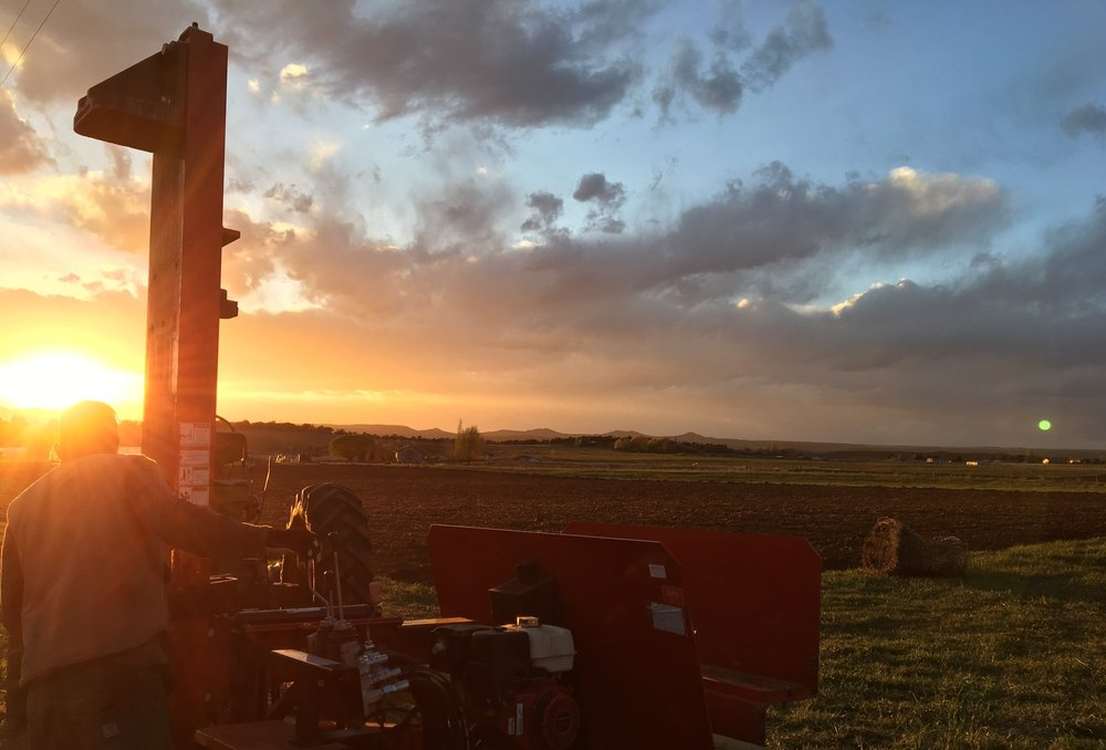 Mike running the post pounder at sunset