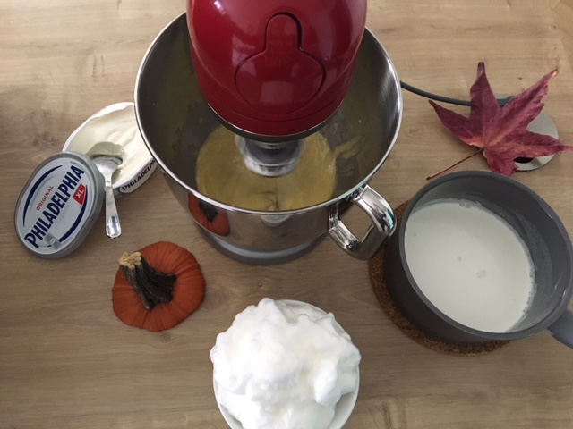 3. Place gelatin in cold water.  4. Whisk the egg yolks and sugar for 5 minutes.  5. Add Philadelphia and ricotta. Mix well.  6. Heat the cream and add the gelatin to melt. Add to mixture.  7. Add pumpkin purée and lemon juice. Mix well.  8. Beat the egg whites until stiff and gently stir in.