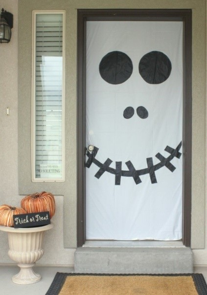 The front door - Simple scary stuff: a few organic pumpkins, an old white sheet, an indelible marker and Bob's your uncle!