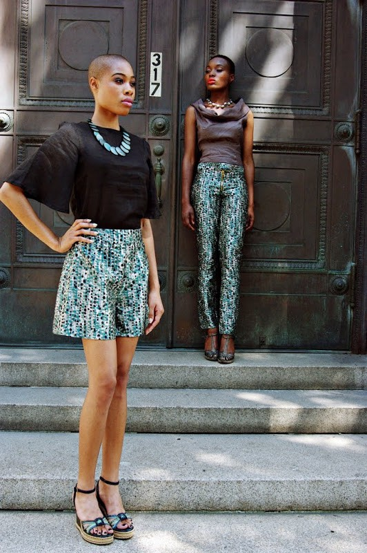Image captured by Kwesi Abbensetts , clothes courtesy of  Anitra Michelle and her Plutocracy line , styled by Jean S. Hall, and make-up by Apryl Rankin. Models: Folasade Adeoso & Liz Coicou