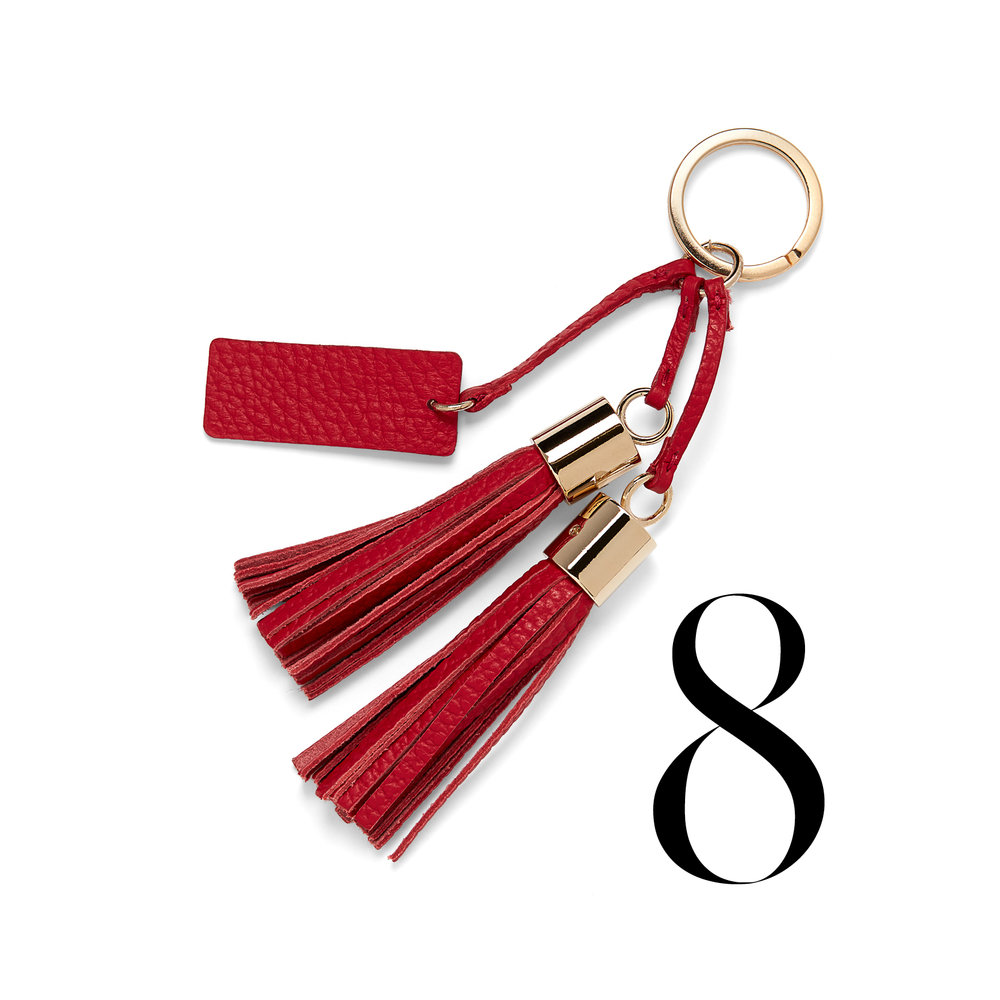 Cuyana - Cuyana has created a movement called the Lean Closet to give victims of abuse a new start in partnership with H.E.A.R.T. Donate things to them that you no longer need, they supply the shipping label, and you receive a $10 credit towards your next purchase. Read more about other initiatives on their website.Red leather Tassel Keychain $55.00