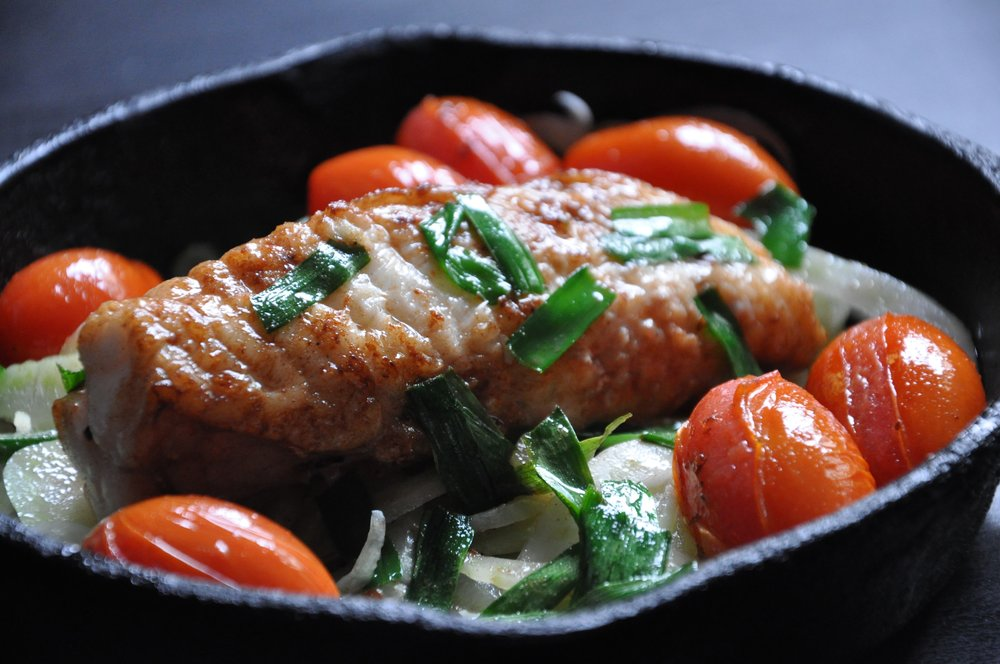 - Roasted monkfish tails with heirloom tomatoes and green onions
